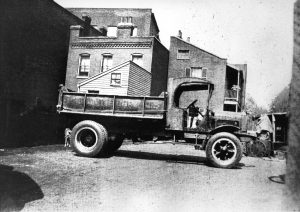 Pic 1 - 5 Ton White Dumpster Truck - 7th & Broadway - 1919-min
